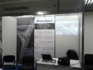 Empty DataFomSky booth with posters at DronItaly 2014