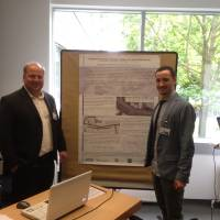 Our poster in Berlin with Andrea Marella (right) and Eng. Bonfanti (left)